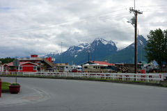 A campground in alaska with snow-capped mountains in the background. Royalty Free Stock Images