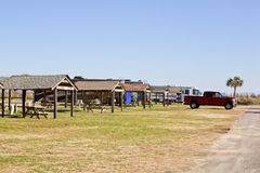 Campground at the beach. A campground at the beach with motorhomes and palm tree Royalty Free Stock Photos