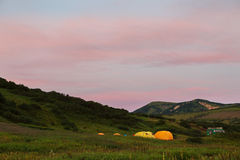 Campground in brookvalley Spokoyny at the foot of outer north-eastern slope of caldera volcano Gorely. Royalty Free Stock Image