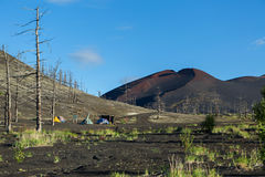 Campground near remains of a helicopter brought down and buried in the eruption of Tolbachik volcano, Kamchatka Stock Photo