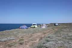 Campground at sea. Campground on the beach in the steppe coast of Crimea Royalty Free Stock Images