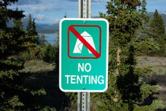 A campground sign indicating no tenting. Stock Photo