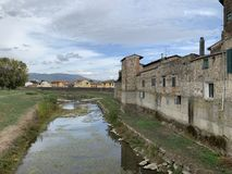 Campi Bisenzio, Tuscany, Italy, view of the town from the bridge. Campi Bisenzio, Tuscany, Italy, October 27th, 2018. Cloudy october day. view of the town from royalty free stock image