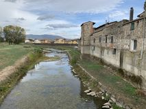 Campi Bisenzio, Tuscany, Italy, view of the town from the bridge. Campi Bisenzio, Tuscany, Italy, October Cloudy october day. view of the town from the bridge stock photography