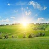 campi, colline ed alba Fotografia Stock