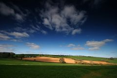 Campi della rappezzatura nel Devon rurale Fotografia Stock Libera da Diritti
