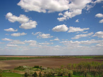 Campi e nuvole Fotografie Stock