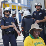 Afro-american woman with police officers at an anti-government protests in Brazil, asking for Dilma Roussefs impeachment. Campinas, Brazil - August 16, 2015 royalty free stock image