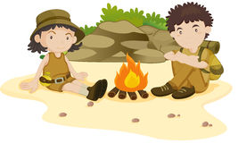 Camping. Two explorers resting by the fire Stock Photography