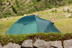 Camping. Tent in a mountain campsite Royalty Free Stock Photography