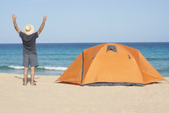 Camping. Happy man camping holidays at the beach stock images