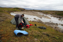 Camping. Lonely traveller camping on the river bank in Iceland royalty free stock photography