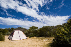 Camping. A single tent in an Australian bush landscape with blue sky Stock Image