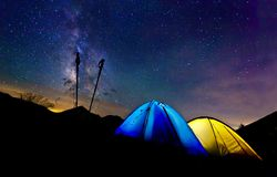 Camping. Two tents illuminated from inside at night in the mountain range Royalty Free Stock Photography