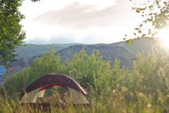 Camping. A beautiful camping area in the mountains at sunset stock photo