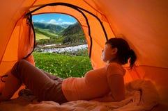 Camping. A girl camping at mountains Stock Photos
