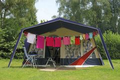 At the camping. Tent at camping with cleaned and washed clothes in front stock image