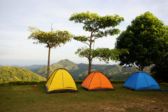 Camping. Three colorful tents with lookout over mountains Royalty Free Stock Photography