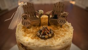 Camping adirondack chairs cake topper for a wedding cake
