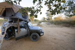 Camping in Africa on rooftop tent royalty free stock images