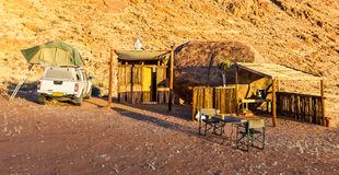 Camping in Africa with wooden shelter cabin in desert sunrise Royalty Free Stock Photography