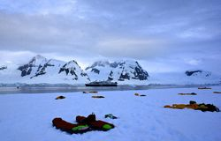 Camping in Antarctica. Bivvy bags are set out on an icy Antarctic Peninsula campsite, ready for intrepid campers to hunker down for the night Royalty Free Stock Photography