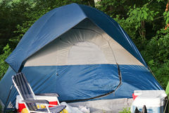 Camping area with blue tent. And chair Royalty Free Stock Photos