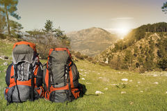 Camping with backpack in the mountain. Stock Photos