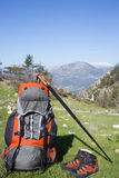 Camping with backpack in the mountain. Royalty Free Stock Image