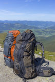 Camping with backpacks in the mountains against the blue sky. Stock Photography