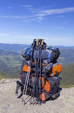 Camping with backpacks in the mountains against the blue sky. Royalty Free Stock Photos