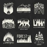 Camping badges, mountains coniferous forest and wooden logo. wild nature. landscapes with pine trees and hills. emblem. Tent tourist, travel for labels Royalty Free Stock Photos