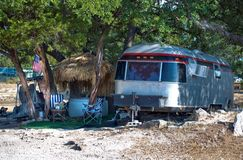 Camping at the Beach. Funky beach campsite in the shade Royalty Free Stock Photo