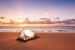 Camping on the Beach. At Sunset royalty free stock photography