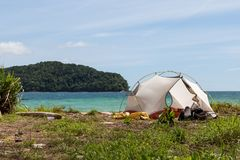 Camping on a beach of an uninhabited island. Tropical jungles landscape, blue sea water and paradise beach camping. Exotic location for camping on beach Royalty Free Stock Photo