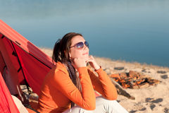 Camping beach woman by campfire in tent Royalty Free Stock Image