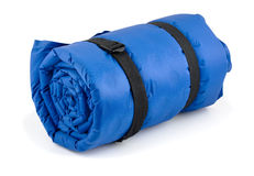 Camping bed. Rolled blue inflatable camping bed isolated on white royalty free stock photography