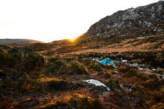 Camping in the Bluestack Mountains in Donegal Ireland. Green tent in the wilderness of Donegal and the Bluestack Mountains. Setting sun and beautiful landscape Royalty Free Stock Photos