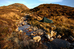 Camping in the Bluestack Mountains in Donegal Ireland. This spot is located in the Bluestack Mountains, surrounded by mountains, sheep and rivers Stock Photo