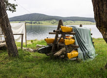 Camping boats and tents. Near the lake in the mountains Royalty Free Stock Photo