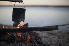 Cooking on a campfire in the open air royalty free stock photography