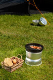 Camping breakfast. Eggs and bacon by the tent Royalty Free Stock Photography