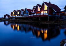 Camping cabins on a fjord at night Royalty Free Stock Image