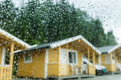 Camping cabins in heavy rain Royalty Free Stock Photo