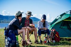 Camping camp in nature happy friends sitting discuss together in. Summer at nature forest stock photography