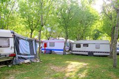 Camping camper camp green outdoor trees Royalty Free Stock Images