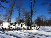 Camping campground in winter. Cold winter campground travel trailer travelers vacation snowbird camping campground royalty free stock images