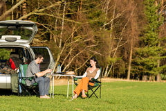 Camping car young couple enjoy picnic countryside. Camping car happy young couple enjoy picnic sunny countryside Stock Photography