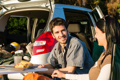 Camping car young couple enjoy picnic countryside. Camping car happy young couple enjoy picnic sunny countryside Stock Image