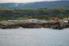 Camping roulotte Llanes. Camping of caravans in the city of Llanes, in front of the port, on the edge of a cliff to the sea. Asturias, Spain stock image